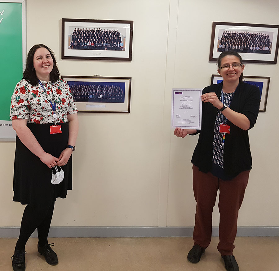 Professional Maths Mentors Dr. Hazel and Mrs. Williams are pictured with a certificate of appreciation from The University of Manchester.